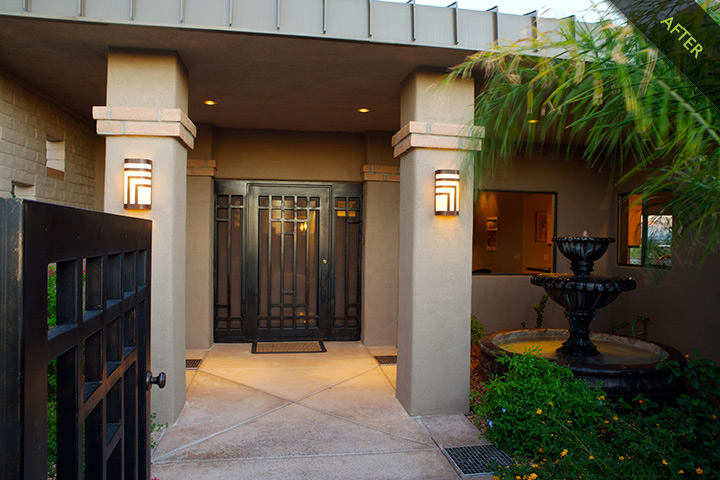 6- Modified the existing mansard roof and wood shake singles at the front entrance, removed existing columns, gothic wall sconces,  and horseshoe shaped exterior wall. New patio walls for cozy entry with fountain, custom designed iron security door and gate, standing seam metal roof and stucco columns