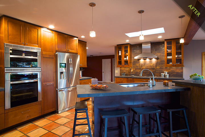 8- Modern remodeled Kitchen with slate kitchen countertops, metallic porcelain backsplash, custom kitchen textured raked drywall with grout panel at backside of kitchen island and southwestern Saltillo kitchen tile floors. Kitchen appliance by Electrolux induction kitchen cook top, oven, microwave and refrigerator combined with a Delta kitchen hands free faucet utilizing the newest in kitchen design and kitchen trends.