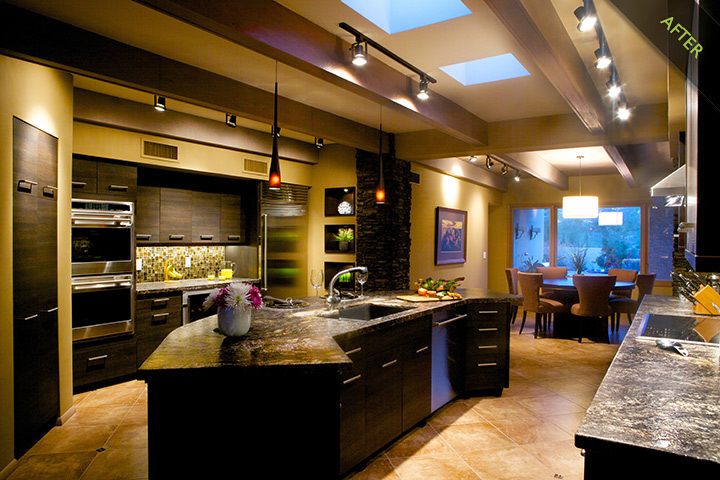 12-Contemporary Kitchen remodel renovation with frameless textured laminate kitchen doors and kitchen drawer fronts with an ebony finish by Bellmont Kitchen Cabinet Co. 3cm honed Cosmos Granite kitchen countertops with leather finish complement the kitchen stack stone columns and 20inx20in porcelain kitchen floor tile.  Kitchen appliances by Subzero Wolf.  Franke under mounted Fire Clay kitchen sink, Kitchen faucet by Grohe and kitchen recessed niches wrapped with matching cabinet kitchen wood species and accented kitchen lighting and hand-blown glass pendants for the kitchen island