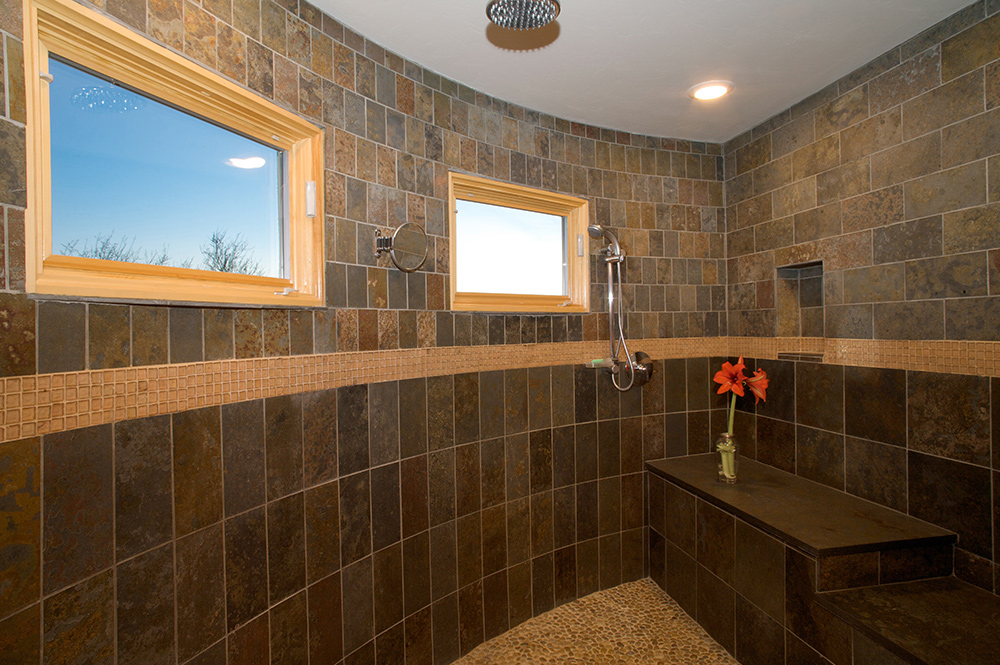 Master Bath With Dramatic Walk In Rain Shower Featuring Pella Windows Slate Wall Tiles Traditional Bathroom Remodel