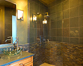 Pool bathroom remodel, cantilevered vanity cabinets, slate countertop, glass vessel sink, roll in accessible shower with stack stone and slate tile shower surround, shower floors pebble rock