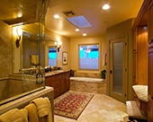 Traditional Master Bathroom remodel with roll in accessible steam shower access, Jacuzzi jetted bath tub, private glass door for water closet room space and built-in make-up vanity counter.