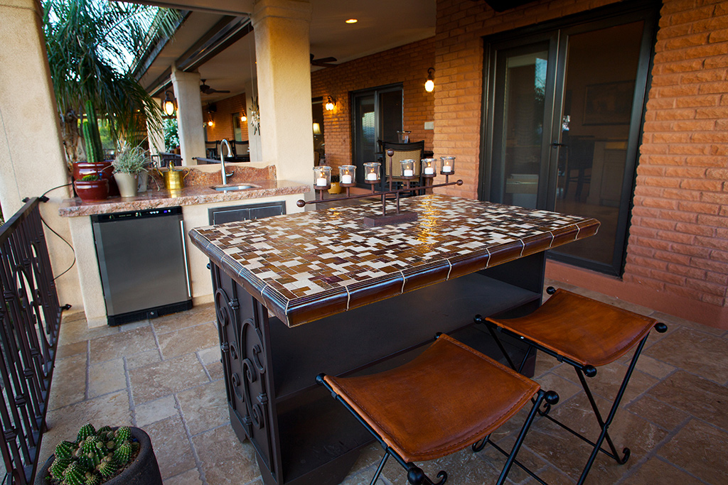 outdoor kitchen with travertine floors metal island cabinets on wheels with glass tile countertops granite
