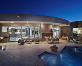 Desert Modern Exterior, Outdoor Entertaining: Mezzo gas fireplace, barbeque station with black slate countertop, porcelain tile patio, custom stainless steel with glass retaining railing.