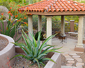 Octagon Gazebo antiqued concrete CDI columns on stucco bases, mission tile roof, flagstone walkways and tiered planters