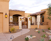 Guest house addition custom wrought iron fence and gate flagstone walkways