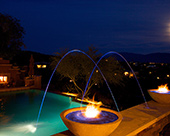Outdoor Entertainment space with fireplace, pool concrete CDI gas fire bowls with glass sand, Pentair Magic Stream pool lighting LED luminars