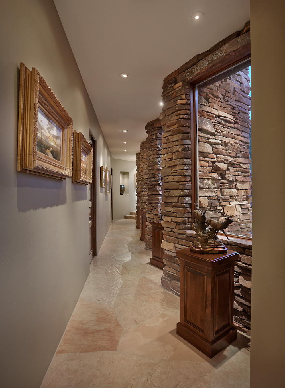 Contemporary Art Hall Natural Stone Columns Anchor The Hallway And Frame Windows To Allow Ample