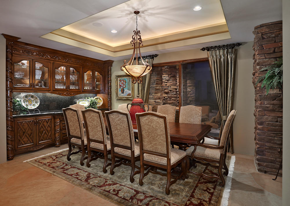 Tuscan Influenced Dining Room Coffered Ceiling With Chandelier Recessed And Indirect Ambient Lighting